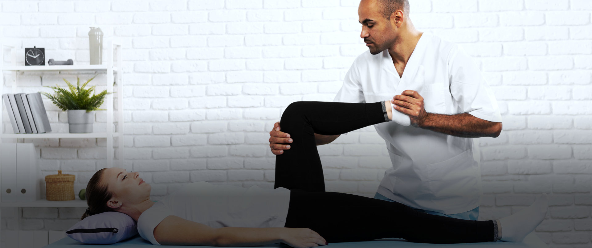 patient and physical therapist treatment on legs