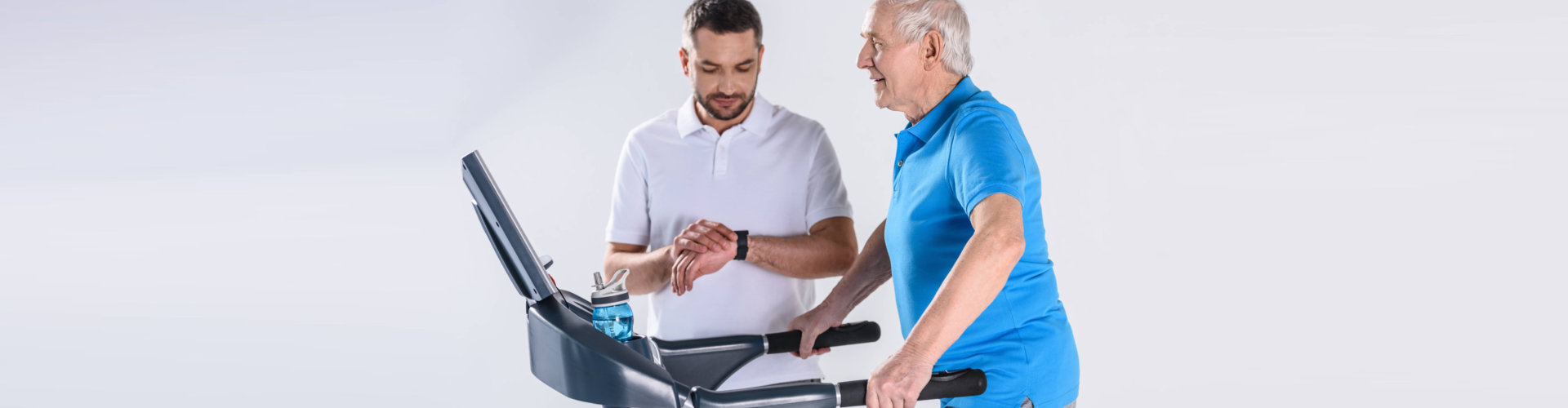 physical therapist assisting elderly doing exercise