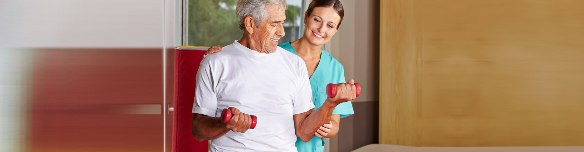 physical therapist assisting the elderly