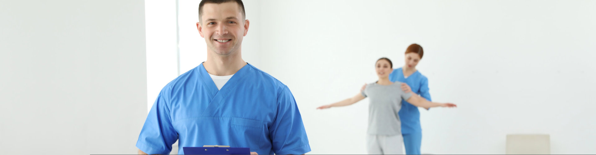 Portrait of professional physiotherapist with clipboard in rehabilitation center. Space for text