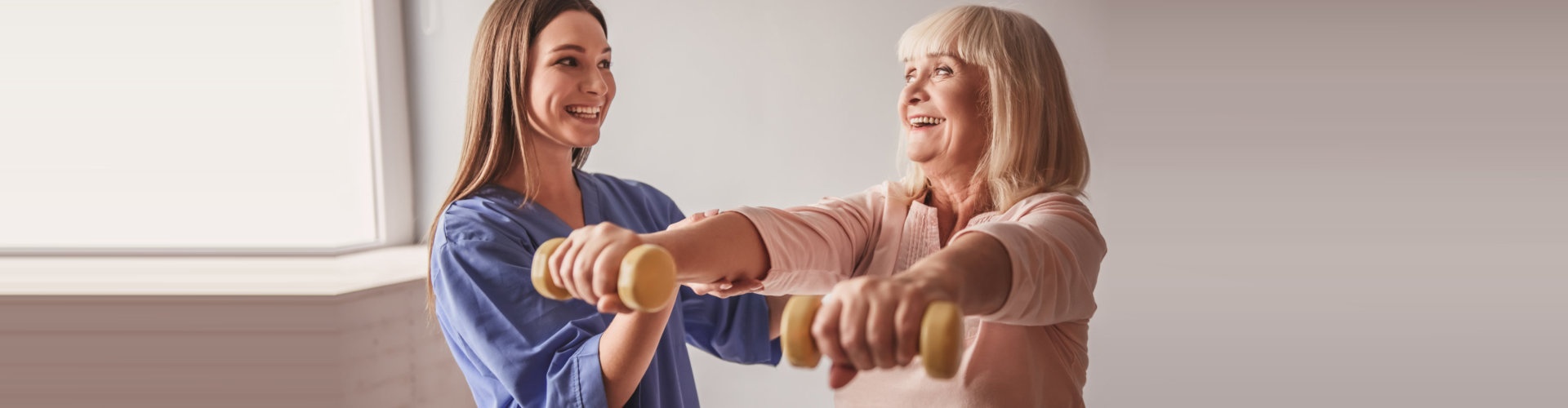 physical therapist and elderly woman doing an exercise